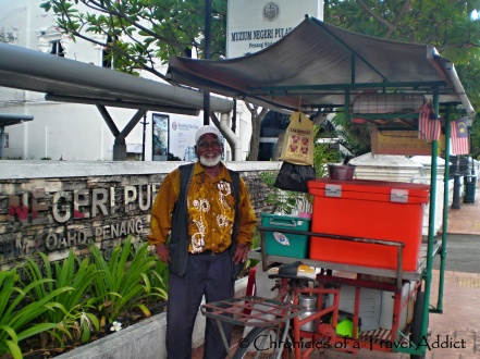 Friendly man selling street food in Penang