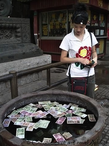 A Chinese girl makes a wish at the Lama Temple