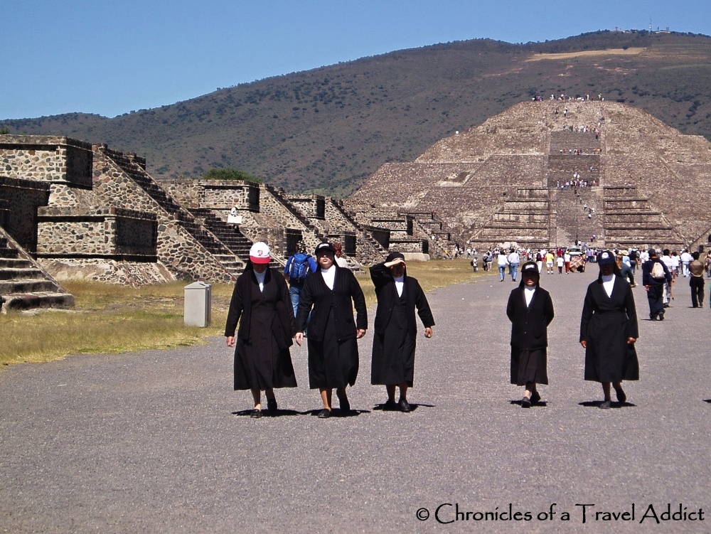 Nuns walking in front of the Temple of the Moon, Teotihuacan