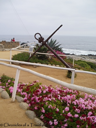 An anchor decorates the pathway to the beach