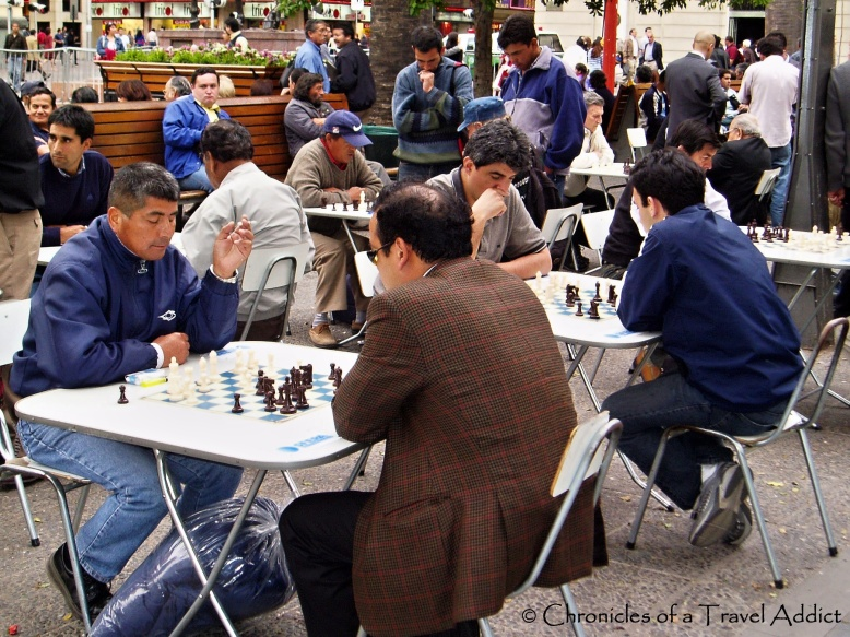 Chilean men intently playing chess in Santiago, Chile