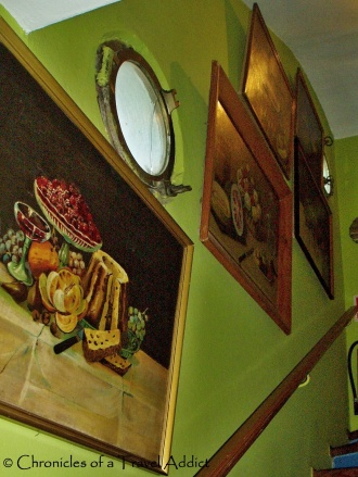 Still life, green walls, and ship-inspired windows