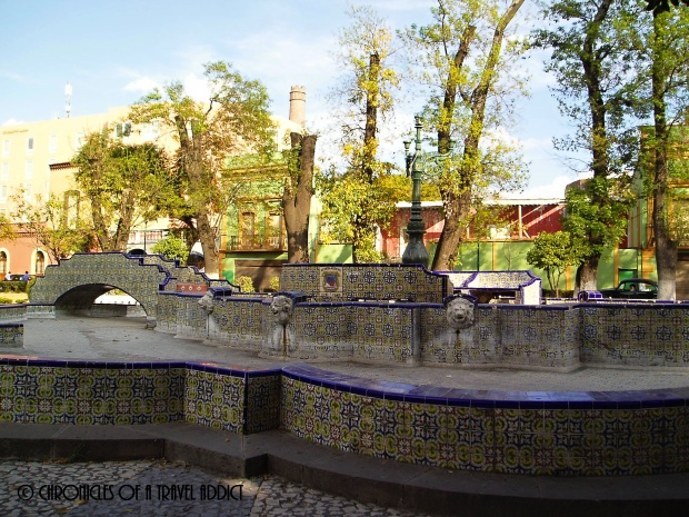 Fountain in Puebla, demonstrating one of the many ways azulejos are used in architecture.