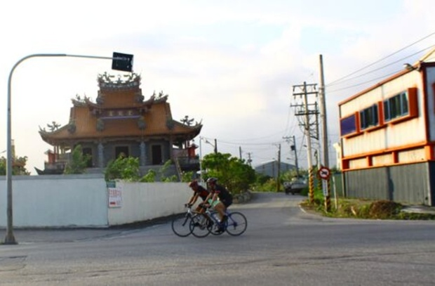Cycling past temples